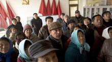 Villagers meet in the local Communist Party Office, which they have taken over after a disputed local election linked to corrupt officials in Panguanying. (Adam Dean for The Globe and Mail)