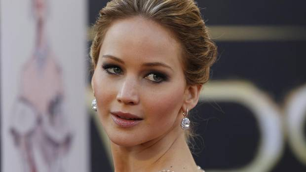"Jennifer Lawrence, best actress nominee for her role in the film ""Silver Linings Playbook"", arrives at the 85th Academy Awards in Hollywood, California February 24, 2013. (LUCAS JACKSON/REUTERS)"