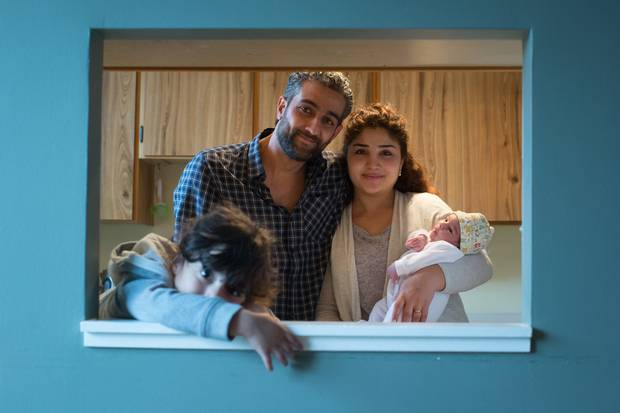 Rami Albarko and his wife, Salma Shaker, are shown at their Vancouver home with their daughters, two-year-old Lilyan, left, and two-week-old Rosel. The Syrian refugees are a government-sponsored family who have been housed and supported by a private sponsorship group since arriving in Canada.