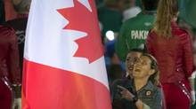 Christine Sinclair carries the Canadian flag into the Closing Ceremonies of Olympic Games in London on Sunday August 12, 2012. (Frank Gunn/THE CANADIAN PRESS)