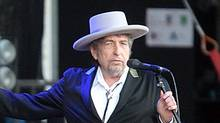 "This July 22, 2012 file photo shows U.S. singer-songwriter Bob Dylan performing on at ""Les Vieilles Charrues"" Festival in Carhaix, western France. (David Vincent/Associated Press)"