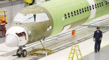 A Bombardier Q400 airliner being assembled at the company's plant in Toronto. (Darren Calabrese/THE CANADIAN PRESS)