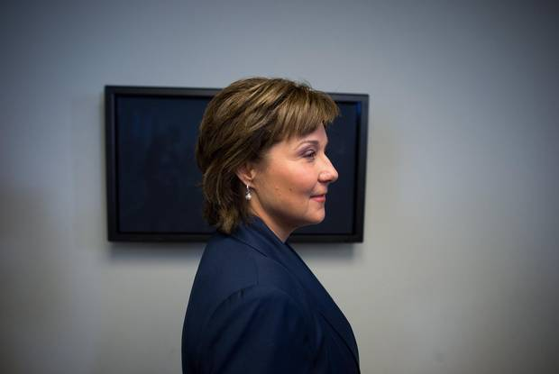 B.C. Premier Christy Clark leaves after a news conference in Vancouver on Tuesday.