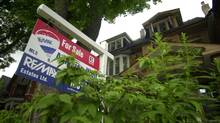 For sale sign sits outside a Toronto home in this file photo. (Fred Lum/Fred Lum/The Globe and Mail)