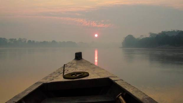 An early morning excursion lets you watch the sun rise over the Rio Madre de Dios. (Carolyn Ireland/The Globe and Mail)