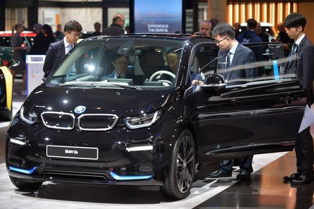 Visitors look a BMW I3s at the 2017 Frankfurt Auto Show 'Internationale Automobil Ausstellung' (IAA) on September 13, 2017 in Frankfurt am Main, Germany.
