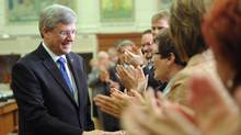 Prime Minister Stephen Harper arrives to address his caucus on Parliament Hill in Ottawa on Wednesday, May 2, 2012. (Sean Kilpatrick/The Canadian Press/Sean Kilpatrick/The Canadian Press)