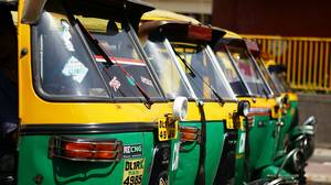 Rickshaws lined up on a street in Old Delhi, India.
