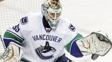 Canucks goalie Cory Schneider prepares to see more action with Vancouver. (AP Photo/Jim Mone) (Jim Mone)