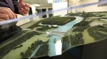 A model of the proposed Site C dam is on display at the Community Consultation Office in Fort St. John, B.C., on Jan. 16, 2013. (DEBORAH BAIC/THE GLOBE AND MAIL)