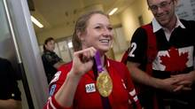 Gold medalist Rosie MacLennan shows her gold medal won at the London Olympics in 2012. as she arrives to a crowd of supporters at Toronto's Pearson Airport Aug 13, 2012. MacLennan won Canada's only gold at the London games winning in trampoline. (Moe Doiron/The Globe and Mail) (Moe Doiron/The Globe and Mail)