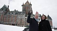 Quebec Premier Jean Charest and Alberta Premier Alison Redford pass by Quebec City's Chateau Frontenac after a meeting on Wednesday. (Jacques Boissinot/The Canadian Press)