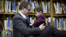 Matthew Quetton with son Theo at his school in Vancouver January 7, 2011. His son has a genetic mutation that causes him to grow very slowly. He'll need 24-7 care for the rest of his life. His dad has an RDSP set up so the family can help the boy achieve financial independence, rather than relying on welfare, as many disabled people are forced to do. (John Lehmann/The Globe and Mail) (John Lehmann/The Globe and Mail)