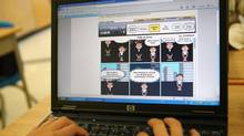 Grade 6 student Nathaniel McMurray creates a comic using Bitstrips at Charles Howitt Public School in Richmond Hill, Ont., on Oct. 19, 2009. (Charla Jones)