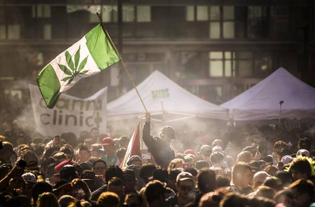 People participate in a cannabis rally in Toronto in 2016. Facing the advent of cannabis legalization in Canada, some companies such as AnantLife are coming to market with genetic tests, left, to evaluate risk of cannabis dependence or cognitive side effects.