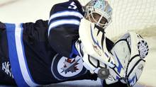 Winnipeg Jets' goaltender Chris Mason makes a save against the Carolina Hurricanes during the third period of their NHL game in Winnipeg October 22, 2011. The Jets won 5-3. REUTERS/Fred Greenslade (FRED GREENSLADE)