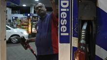 A worker switches on a fuel pump before filling a car with diesel at a fuel station in New Delhi September 13, 2012. (MANSI THAPLIYAL/REUTERS)