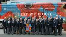 Members of the Royal Canadian Legion's Tri-District Hospital Committee's ABC & DEF and the Ladies' Auxiliary present the keys to the coach bus presented to Sunnybrook veterans on September 8th. (Supplied)