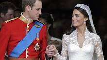 Britain's Prince William and his wife Catherine, Duchess of Cambridge, stand outside of Westminster Abbey after their Royal Wedding in London on April 29, 2011. (Martin Meissner/Martin Meissner/AP)