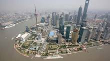 An aerial view shows Shanghai's new financial district skyline along the Huang Pu river. (REUTERS)
