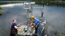 Scientists set up micro-meterological station on a raft in this undated photo from the Experimental Lakes Area research station in Northwestern Ontario. (Handout/The Canadian Press)