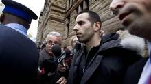 Alessandro (Sandro) Lisi, with his lawyer, Seth Weinstein, near, is escorted out of Old City Hall Court in Toronto on Nov. 1, 2013 after getting bail on extortion charges. (Peter Power/The Globe and Mail)