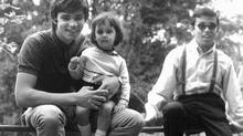 Carolyn Abraham in the lap of her brother Conrad, on holiday in the English countryside in 1972. At right her siblings Kevin and Christine and their father, Dudley Abraham.
