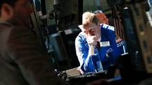 Traders work on the floor of the New York Stock Exchange on July 2, 2012. (Brendan McDermid/Reuters)