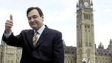 Justice Minister Martin Cauchon gives a sign of approval in front of Parliament Hill on May 27, 2003. (JIM YOUNG/Reuters)