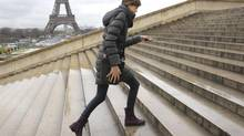 Swiss model Julia Saner runs up the stairs near the Eiffel tower as she leaves a fashion show for an other during the Haute Couture fashion week in Paris January 26, 2011. Saner, an 18-year-old top model, was in Paris during the Haute Couture Spring-Summer 2011 fashion collections. (© Philippe Wojazer / Reuters/Reuters)
