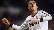 Real Madrid's Cristiano Ronaldo celebrates after scoring his second goal against Deportivo Coruna during their Spanish first division soccer match at Santiago Bernabeu stadium in Madrid September 30, 2012. (SERGIO PEREZ/REUTERS)