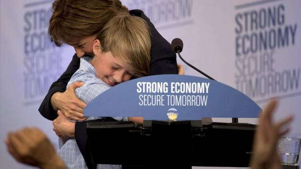 B.C. Liberal Leader Christy Clark hugs her son Hamish,11, after winning the provincial election on May 14, 2013. (JONATHAN HAYWARD/THE CANADIAN PRESS)