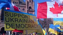 Ukrainian Canadians rally at Queen's Park in Toronto Sunday. (ivan semeniuk/globe and mail)