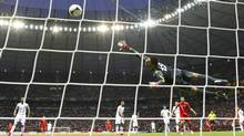 Greece's goalkeeper Michalis Sifakis saves the ball during their Group A Euro 2012 soccer match against Russia at the National stadium in Warsaw, June 16, 2012. (KAI PFAFFENBACH/REUTERS)