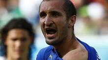 Italy's Giorgio Chiellini shows his shoulder, claiming he was bitten by Uruguay's Luis Suarez, during their 2014 World Cup Group D soccer match at the Dunas arena in Natal June 24, 2014. (Reuters)