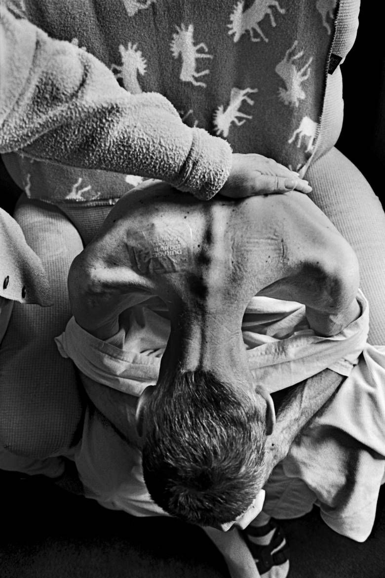 Blayne Kinart is comforted by his wife Sandy after receiving a painkiller in the form of two patches stuck to his upper back. The 58-year-old former chemical worker died from Mesothelioma, a cancer associated with asbestos exposure on July 6, 2004.