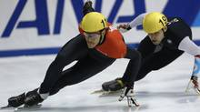 Canada's Olivier Jean, and Jeff Simon of U.S. compete in the men's 500 meter preliminaries during the ISU Short Track World Cup speed skating competition in Nagoya, central Japan, November 30, 2012. (Reuters)