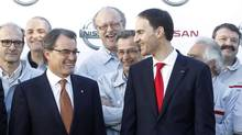 Catalunya's President Artur Mas, left, speaks with Nissan Motor Iberia's president Frank Torres after a news conference Feb. 4, 2013 announcing the manufacture of a new car model at the factory in Barcelona. (ALBERT GEA/REUTERS)