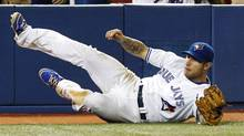 Toronto Blue Jays third baseman Brett Lawrie makes a diving catch against the Baltimore Orioles in foul territory during the ninth inning of their MLB American League baseball game in Toronto, May 29, 2012. (MARK BLINCH/Reuters)