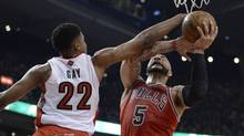 Toronto Raptors forward Rudy Gay, 22, defends against Chicago Bulls forward Carlos Boozer during first half NBA action in Toronto on Friday April 12, 2013. (Frank Gunn/THE CANADIAN PRESS)