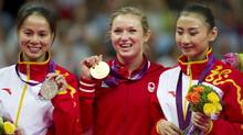 China's bronze medalist He Wenna, left, Canada's gold medalist Rosannagh MacLennan, centre, and China's silver medalist Huang Shanshan display their medals for the women's trampoline at the 2012 Summer Olympics in London on Aug. 4, 2012. (Kevin Van Paassen/The Globe and Mail)