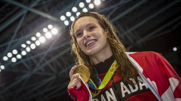 Penny Oleksiak after she won gold in Women's 100m Freestyle Final at Olympic Aquatics Stadium during Rio Olympics August 11, 2016.