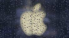 Raindrops are seen in front of an Apple logo outside an Apple store in Shanghai February 22, 2012. (ALY SONG/ALY SONG/REUTERS)