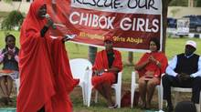 "A member of the Abuja ""Bring Back Our Girls"" protest group addresses a sit-in demonstration organized by them, at the Unity Fountain in Abuja June 23, 2014. (AFOLABI SOTUNDE/REUTERS)"