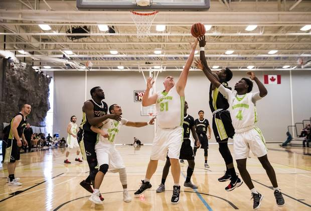 Algonquin College Thunder 38-year-old rookie Dan Stoddard goes up for a rebound against the Centennial Colts during their OCAA basketball game in Toronto, on Nov. 4.