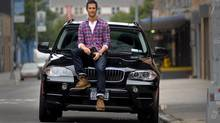 Tyler Harcott and his BMW X5. (Neville Elder for The Globe and Mail)