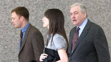 Conrad Black (R) enters the Dirksen Federal Court Building for his fraud and racketeering trial with his daughter Alana Black (M), son Jonathan Black (L) in Chicago, Illinois May 15, 2007. (REUTERS/STEPHEN J. CARRERA/REUTERS/STEPHEN J. CARRERA)