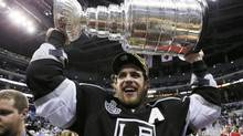 Los Angeles Kings' Anze Kopitar hoists the Stanley Cup (LUCY NICHOLSON/REUTERS)