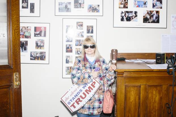 Trump supporter Holly Couture stands in the Secretary of State's office after he filed his candidacy in the New Hampshire primary. Ms. Couture said she was so excited at the chance to meet Mr. Trump that she couldn't get to sleep until 1 a.m. the night before. She got his autograph on the campaign sign and tried to get a picture with him, but her camera failed.
