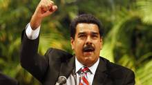 Venezuelan President Nicolas Maduro gestures during a meeting with South American trade group Mercosur members in Caracas, July 9, 2013. Venezuela's June inflation slowed from the previous month's 6.1 per cent to 4.7 per cent, the central bank said on Tuesday. (Carlos Garcia Rawlins/REUTERS)